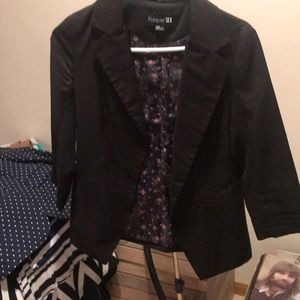 Blazer with floral lining.